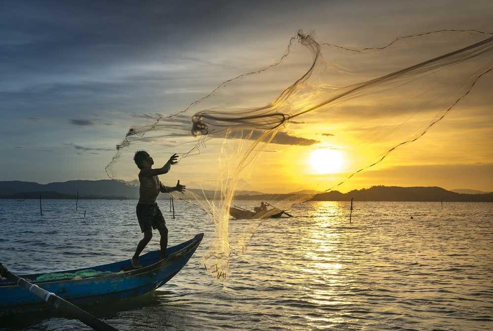 Pêcheur dans la lagune de Tam Giang