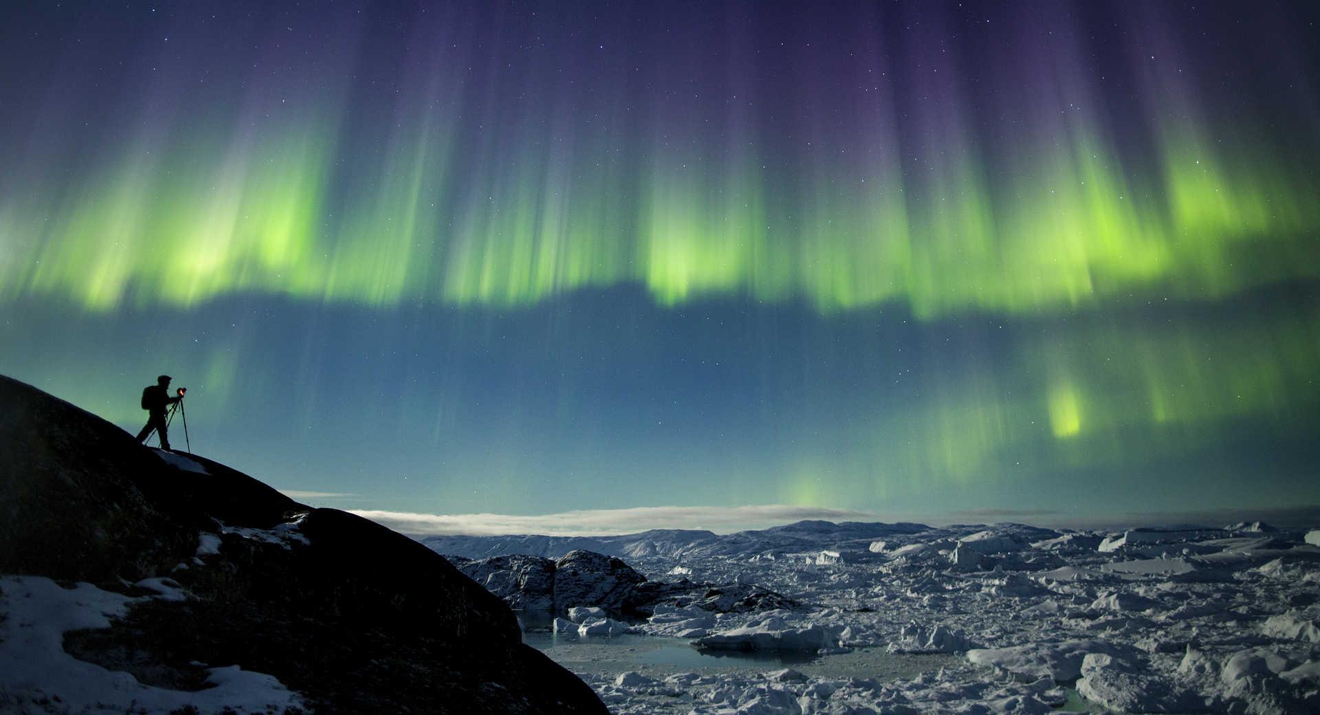 Photographe sous les aurores au groenland