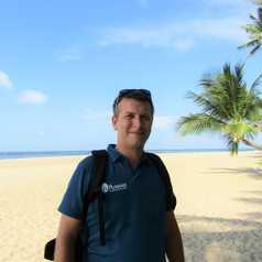 Olivier sur une plage paradisiaque