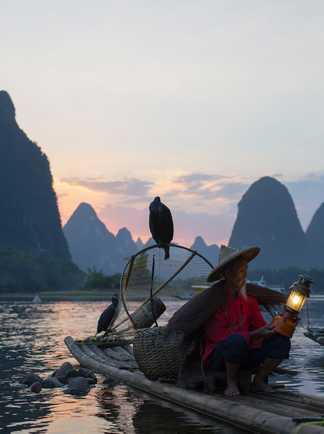Pêcheur sur la rivière Li, Yangshuo, Guilin